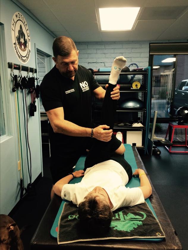 Owner Al Vishnevetsky works with a rehabilitation client.